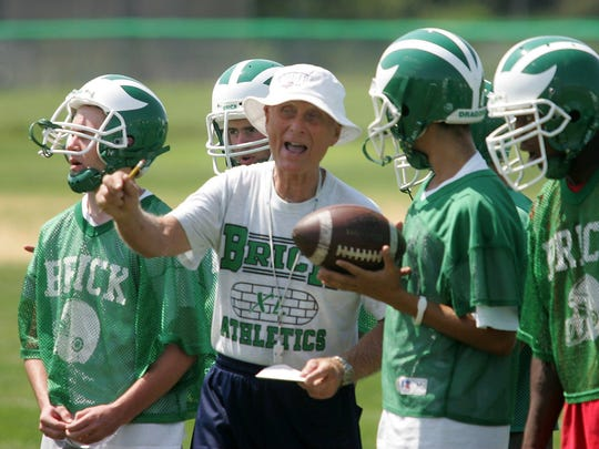 8/17/05 BRICK BY TOM SPADER Brick football TAB: Head coach Warren Wolf in action with the off. unit