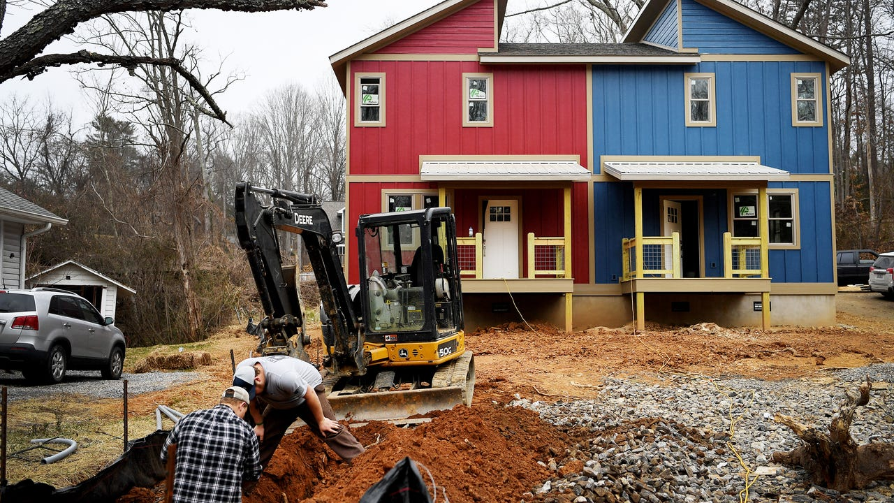 Kyle Henry and Aaron Palmer, partners in Ground Floor Properties NC, have a nearly finished duplex on State Street. Each 1,100-square-foot unit is selling for $279,000.