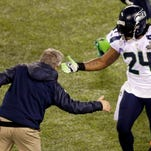 Seattle Seahawks head coach Pete Carroll celebrates with Marshawn Lynch (24) during the first half of the NFL Super Bowl XLVIII football game against the Denver Broncos Sunday, Feb. 2, 2014, in East Rutherford, N.J. (AP Photo/Charlie Riedel)