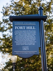 Clemson University placed 11 signs in front of historical