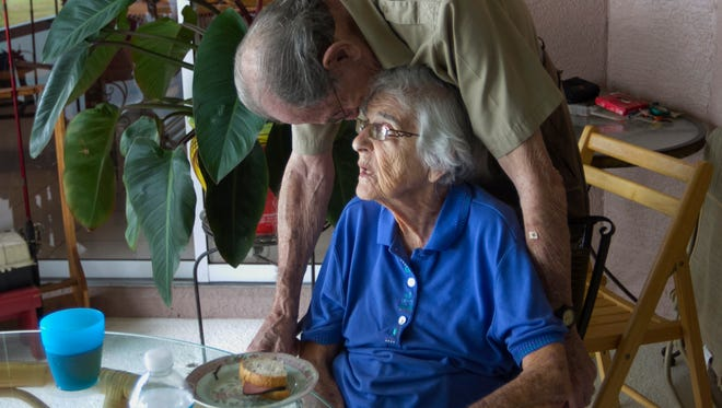 Will Needleman leans in to give his wife Mildred some affection while trying to coax her into eating lunch. Mildred is in the late stages of Alzheimer's Disease and does not remember much anymore.