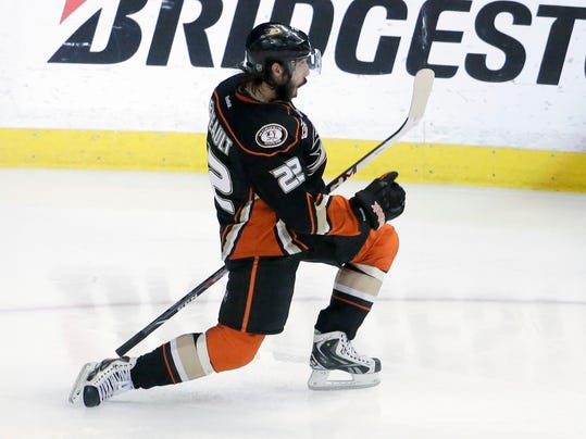 Anaheim Ducks center Mathieu Perreault celebrates after scoring during the second period in Game 5 of an NHL hockey second-round Stanley Cup playoff series against the Los Angeles Kings in Anaheim, Calif., Monday, May 12, 2014. (AP Photo/Chris Carlson)