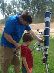 Backyard astronomy can be a family activity. Jim Waltman's