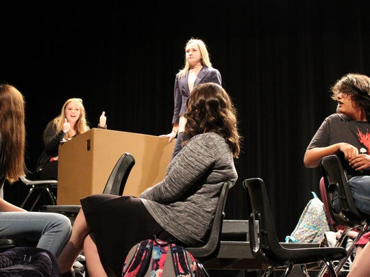 "An English teacher (juior Hannah McLean), standing, gets a reaction from Alice (senior Sarah Frazier) in this rehearsal scene of ""Governing Alice,"" one of two drams being performed this weekend at Abilene High."