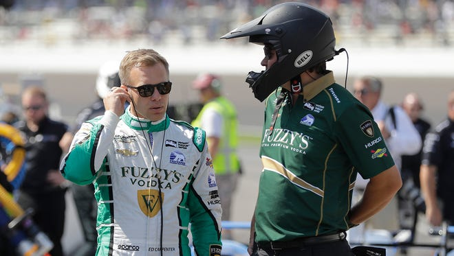 Ed Carpenter talks with a crew member during the final practice session for the Indianapolis 500.