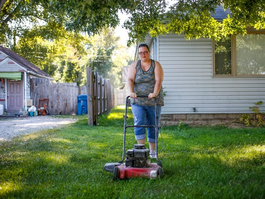 """""""I bought a mower today,"""" said Laura Warrick, as she"""