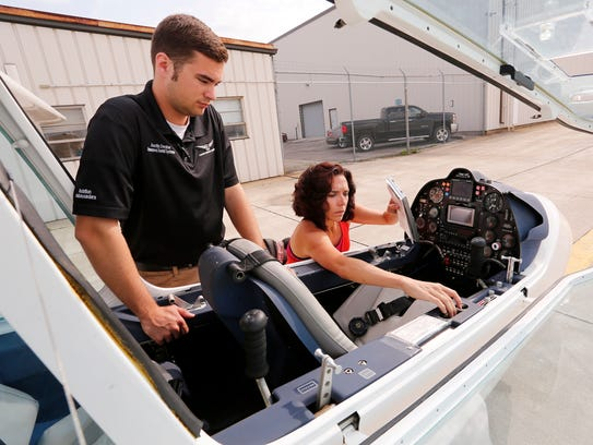 Emily Hupe performs a pre-flight check of a Sky Arrow light sport plane as flight instructor Austin Decker observes Tuesday, May 22, 2018, at Purdue Airport. Hupe, who is from Temecula, California, is learning to fly in the Able Flight program.