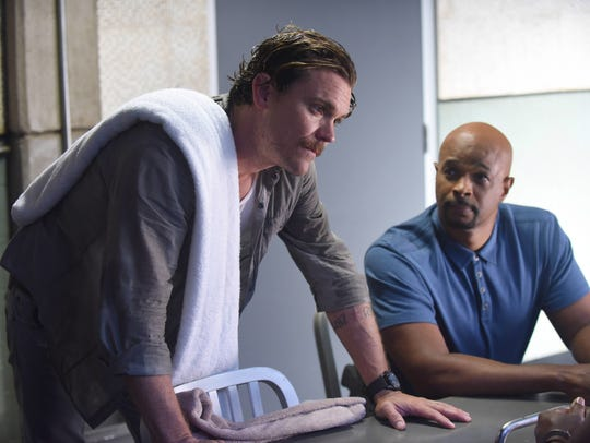 """Lethal Weapon"" is in jeopardy after a report that star Clayne Crawford (left, with Damon Wayans) was fired by Warner Bros., which is said to be  seeking a replacement."