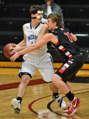 Rocori's Ryan Hennen (11, right) tries to knock the