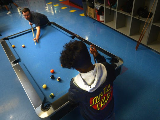 Cody Bowen, left, shoots pool earlier this month with a teenager who's part of the Evening Reporting Center at the Boys & Girls Club Teen Center in Oxnard.