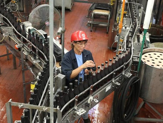 Judy Anderson works on the bottling line at Canandaigua