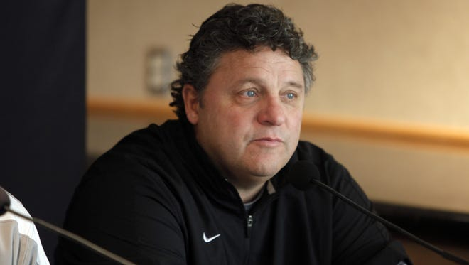 Oakland University basketball coach Greg Kampe talks with reporters Oct. 12, 2012, at the O'rena in Rochester.