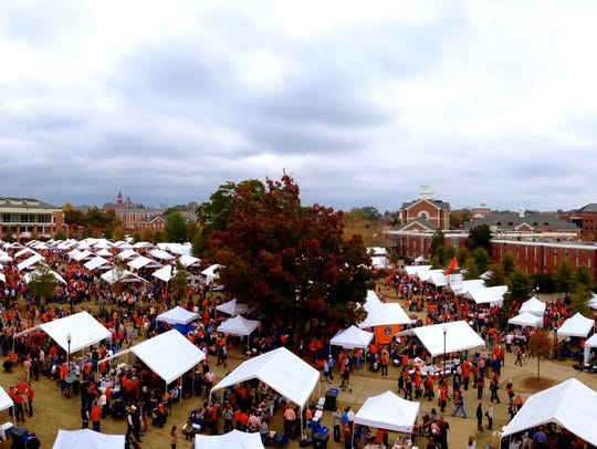 Rows of Tailgate Guys tents set up before an Auburn