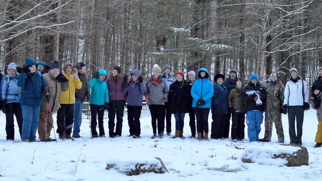 Owl Hoot Night hikers gather at the trailhead at Niquette Bay State Park in Colchester.