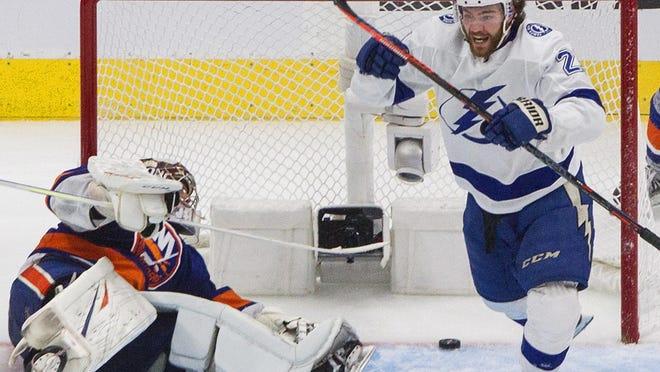 Tampa Bay Lightning's Brayden Point (21) celebrates his goal against New York Islanders goalie Semyon Varlamov.