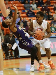UTEP's Dominic Artis, right, collides with Alcorn State's Devonte Hampton during the first half Sunday Nov. 22, 2015. Hampton was called for a foul.