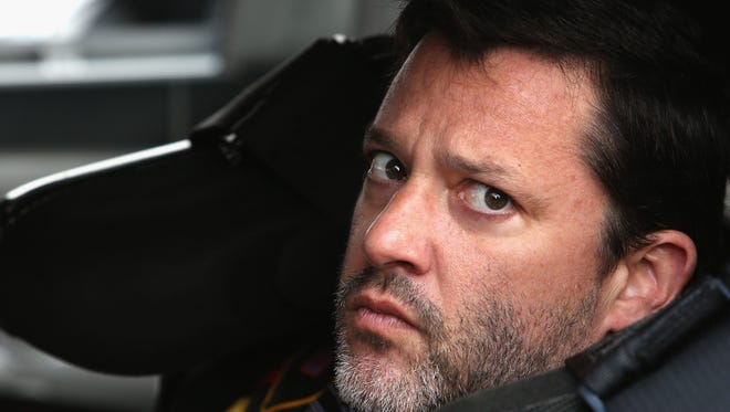 Tony Stewart, driver of the #14 Rush Truck / Mobil 1 Chevrolet, looks on during practice for the NASCAR Sprint Cup Series Auto Club 400 at Auto Club Speedway on March 22, 2014 in Fontana, Calif.