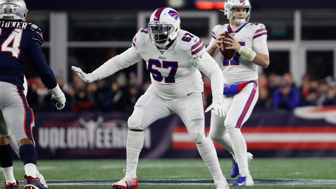Offensive guard Quinton Spain (67) blocks a New England Patriot defensive lineman while playing with the Buffalo Bills in 2019. Spain, a Petersburg native and graduate of Petersburg High, signed with the Cincinnati Bengals on Friday.