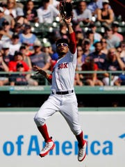 Boston Red Sox right fielder Mookie Betts (50) makes