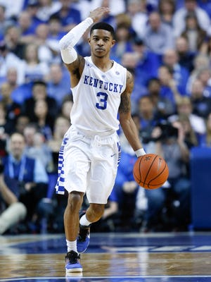 Kentucky Wildcats guard Tyler Ulis (3) dribbles the ball against the LSU Tigers in the second half at Rupp Arena.