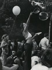 Balloons and bubbles are part of the distraction at the Alternate Site during a 1973 concert.