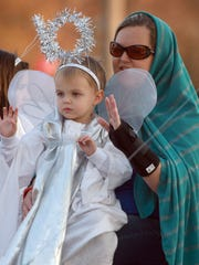 "A little angel rides on the ""A Star is born float"""
