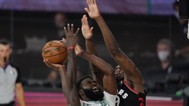 The Celtics' Jaylen Brown, who struggled offensively all game,  tries to shoot over the Raptors' Serge Ibaka during the second half of Saturday night's conference semifinal.