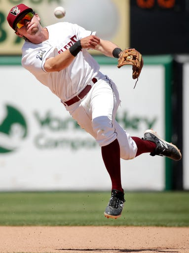 The Timber Rattlers' Trever Morrison leaps into the