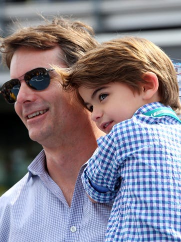 Jeff Gordon carries son Leo out to the Indianapolis