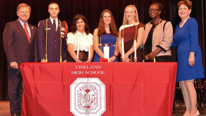(From left) Thomas McCann, Oleh Chernenko, Mia Montalvo, Anita Novatorskaya, Billie Mattioli, Kebeh Oden, and Carole Dallago at the Vineland High School National Honor Society induction ceremony.