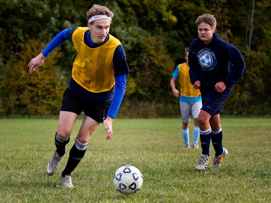 Alex Meiniche, an exchange student from Denmark, attacks the ball during soccer practice Friday, October 9, 2015 at Richmond High School.