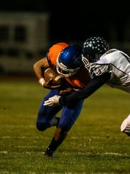 Millville's Marcial Ramos makes a reception against Atlantic City.