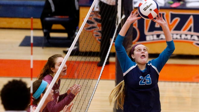 Siegel's Sophia Bossong sets the ball during the state volleyball tournament. The junior recently committed to Chattanooga.