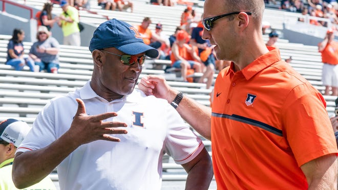 Illinois coach Lovie Smith, left, is greeted by Illinois athletic director Josh Whitman during a 2016 game. Both were disappointed that Big Ten Conference football was postponed until the spring.