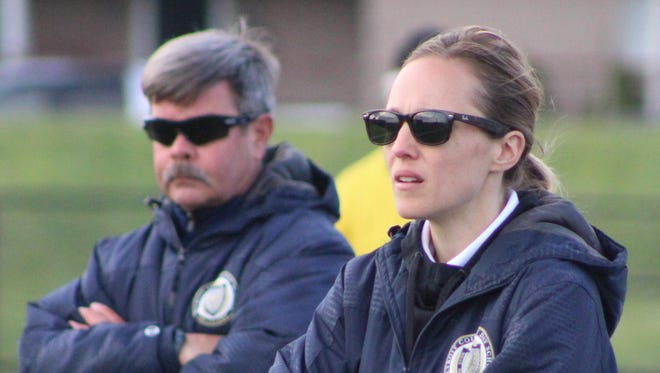 Laura Hamway has the luxury of seeking advice from former head coach and mentor Bob Bukari (background) as she takes over Country Day's varsity girls soccer program this season.
