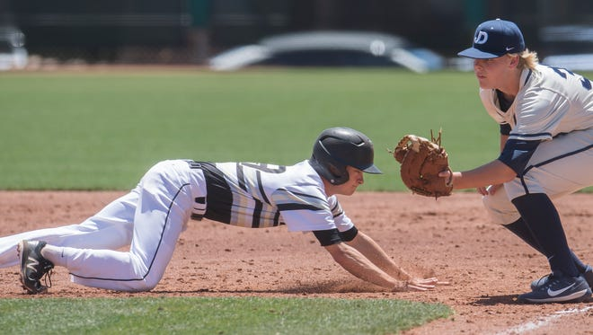 Desert Hills' Bronson Andrus slides safely back to first base against Juan Diego Catholic at the 4A state baseball quarterfinals at Dixie State University Wednesday, May 16, 2018.