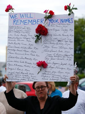 Louise Millman of Bradley Beach attends vigil at QSpot Community Center on main street for the victims of the Orlando nightclub shooting. Ocean Grove on Monday, June 13, 2016.