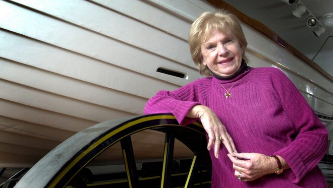 Sue Hurley, Ocean City historian and curator of the Ocean City Lifesaving Museum, poses for a photograph in front of a boat used in lifesaving procedures at the Ocean City Lifesaving Museum in this 2002 photo. Hurley died April 5, 2016, at the age of 79.