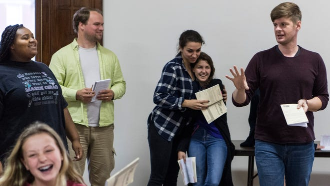 Kevin Roach (from right, counter-clockwise), a Mount Vernon native and the art director of the Evansville Civic Theatre, gives feedback as actors Olivia Schaperjohn, Emily Durchholz, Brent Bredhold, HarMonee Baltzell and Alyssa Chaffee rehearse a scene of The Crucible at First Avenue Presbyterian Church in Evansville, Ind., on Wednesday, Sept. 13, 2017. Roach is recovering from surgery after donating a kidney to his cousin-in-law.