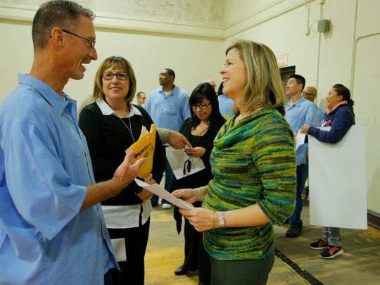 Balance Reentry Activity Groups Chairman Michael Hoskins speaks with Rancho Cielo CEO Susie Brusa when she visited the Correctional Facility Training Facility this week to collect funds that were raised by inmates for Rancho Cielo.