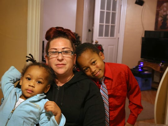 Mary Jo Newtown with her granddaughter A'Niya Holmes, 2, left, and grandson Deveon Timmons, 7, right, in their Rochester apartment Friday, Nov. 25, 2016.