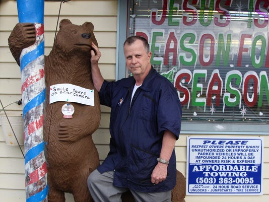 Larry's Family Barbershop reunited with bear statue