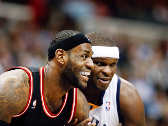 Miami Heat forward LeBron James, left, and Memphis Grizzlies forward Zach Randolph, right, get set for a free throw in the second half of an NBA basketball game Wednesday, April 9, 2014, in Memphis, Tenn. The Grizzlies won 107-102. (AP Photo/Mark Humphrey)