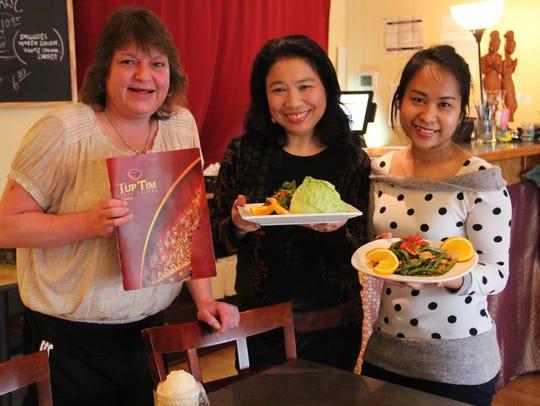 Vichuda Stine (center) owns Tup Tim Thai Cuisine in