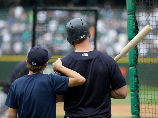 New York Yankees designated hitter Matt Holliday, right, stands with his son Jackson, 13, during batting practice, Friday, July 21, 2017, before the team's baseball game against the Seattle Mariners in Seattle.