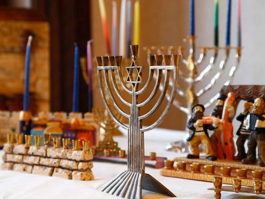 An assortment of menorahs on display at Temple Concord's