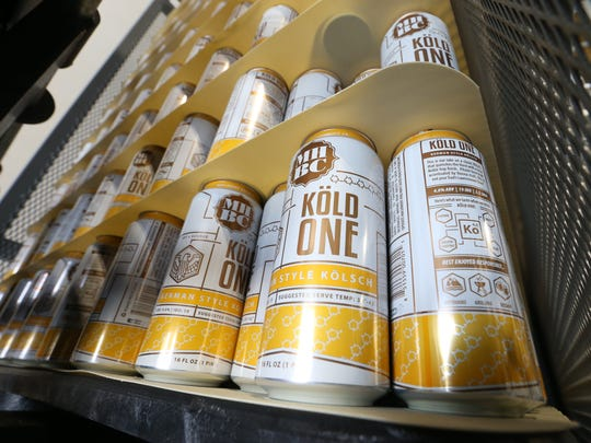 Cans of Köld One beer from Mill House Brewing's after