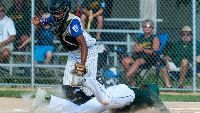 Lower Sussex shortstop Jason Killen (13) slides under the tag for a run against Dover in the Delaware Junior Little League finals Saturday evening.