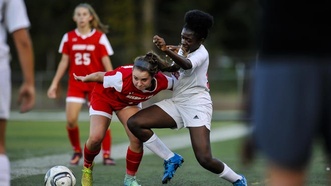 Bishop Ahr's Sarah Glazewski, left , fights for possesion of the ball with Woodbridge's Ikmat Ubrahim during their game in Woodbridge on Sept. 15, 2016.