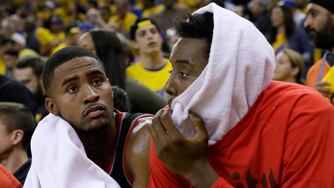 Portland Trail Blazers forward Maurice Harkless, left, and Al-Farouq Aminu sit on the bench during the second half of Game 1 of a first-round NBA basketball playoff series against the Golden State Warriors in Oakland, Calif., Sunday, April 16, 2017.
